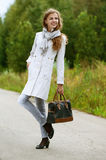 Nice young woman with handbag Stock Photography