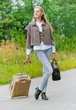 Nice young woman with handbag Stock Images