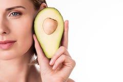 Nice young woman holding avocado Stock Photos