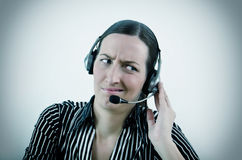 Operator. Nice young woman operator in different situation Royalty Free Stock Image