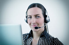 Operator. Nice young woman operator in different situation Royalty Free Stock Photography