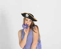 Nice young woman with pirate cd or dvd disk Royalty Free Stock Photography