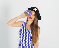 Nice young woman with pirate cd or dvd disk Stock Photo