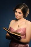 Nice young woman reading book Stock Photography
