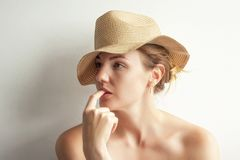 Nice young woman thoughtful and looks away royalty free stock photography