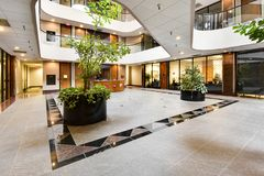 Commercial Building Foyer. A nicecly decorated commercial building foyer first floor greeting area stock photography