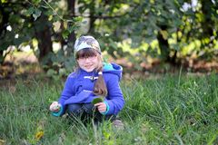 Nicelittle girl in blue coat Stock Image