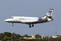 Nicely colored Business Jet landing Royalty Free Stock Photos