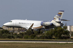 Nicely colored Business Jet landing Royalty Free Stock Images