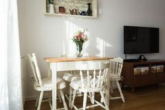 Nicely decorated living  room. Dining table and some chairs stock photos