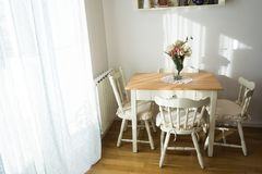 Nicely decorated living  lunch  room. Dining table and some chairs stock images