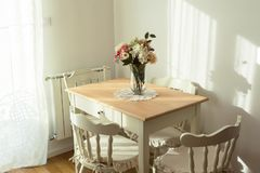 Nicely decorated living  room. Dining table and some chairs stock images