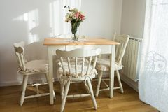 Nicely decorated lunch room. Dining table and some chairs stock images