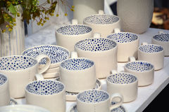 Nicely decorated and served dining. Ceramic cups and saucers Royalty Free Stock Photography