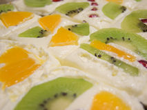 Nicely decorated and tasty cake with tangerine and kiwi Stock Photos