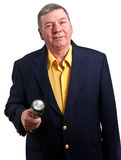 Nicely dressed mature man holding flashlight Royalty Free Stock Photography