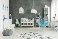 Nicely furnished baby boys room. White and nicely furnished baby boys room Royalty Free Stock Image