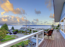 Nicely furnished screened deck overlooking beautiful scenery. Nicely furnished screened deck overlooking beautiful water view Royalty Free Stock Photography