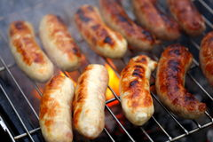 Nicely grilled sausages on a whole background Royalty Free Stock Images