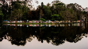 Nicely Lit Lake. Pristine Kodaikanal lake with shops around the bank which lit the lake in the late hours Royalty Free Stock Images