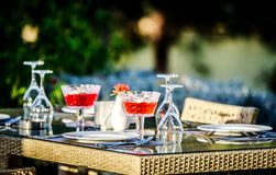 A nicely served table in a Turkish restaurant with a view of the sea in the summer sun. stock photos