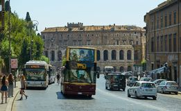 Rome - City museum. Traffic. People on the busstop. Nicest touristic place in the world. Sightseeng bus. People on the busstop. Traffic in Rome Royalty Free Stock Image