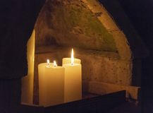 Niche with burning candles stock photography