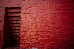 Niche in the red brick wall. Niche in the red painted old brick wall royalty free stock images