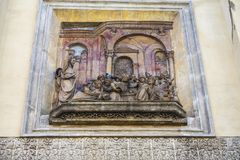 Niche with sculptural representation on the facade of a street in the city of Seville, Spain. Niche with sculptural representation on the facade of a street in royalty free stock photo