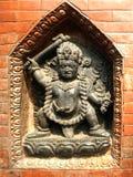 SWAYAMBHUNATH STUPA wall niche shrine. This is a niche statue at SWAYAMBHUNATH STUPA in Kathmandu, Nepal Stock Image