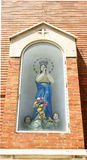 Niche with Virgin on a street i Stock Photos