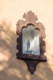 Niche in the wall with religious sculpture Royalty Free Stock Images
