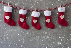 Nicholas Boots As Advent Calendar, cemento, copos de nieve Imagen de archivo libre de regalías
