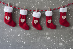 Nicholas Boots As Calendar, cemento, primo arrivo, fiocchi di neve Immagine Stock