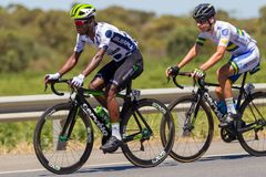 Nicholas Dlamini breaking away on the Tour Down Under Stage 3 18 January 2018. Nicholas Dlamini of Team Dimension Data breaking away on the Tour Down Under Stage stock photos
