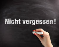 Nicht Vergessen Texts on Black Chalkboard Royalty Free Stock Photos