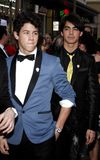 Nick Jonas and Joe Jonas. At the World Premiere of `Jonas Brothers: The 3D Concert Experience` held at the El Capitan Theater in Hollywood, California, United Stock Photo