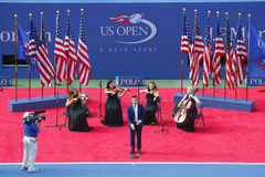 Nick Jonas sings God Bless America before the US Open 2014 Women's singles final. NEW YORK- SEPTEMBER 7 Nick Jonas sings God Bless America before the US Open Stock Photos