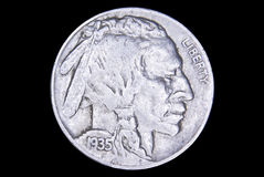 Nickel. Old 1935 Indian head nickel isolated on black background Stock Images