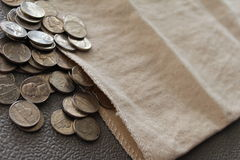 Nickel in a coin bag Stock Images