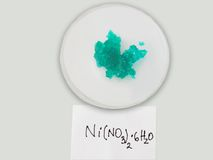 Nickel nitrate. On a clock glass with handwriting notice.Useful image for a basic inorganic chemistry educational presentation Royalty Free Stock Image