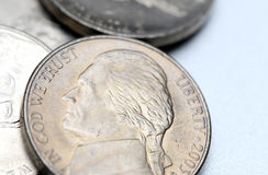 Nickels. Isolated on a silver background stock photography