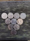 Nickels. In a triangle facing different ways royalty free stock images