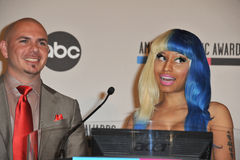 Nicki Minaj, Pitbull. Nicki Minaj & Pitbull at the nominations announcement for the 2011 American Music Awards at the JW Marriott Los Angeles at LA Live. October Stock Photography