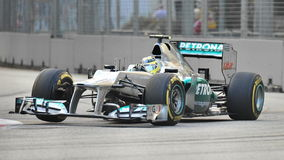 Nico Rosberg racing in F1 Singapore GP Royalty Free Stock Photography