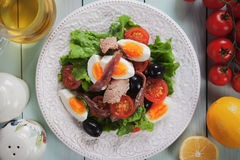 Nicoise salad with eggs, tuna and anchovy. Salad Nicoise with bolied eggs, tuna and anchovy Royalty Free Stock Images