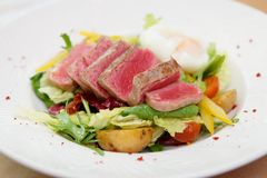Nicoise salad of rare fried tuna, potato, salad mix and poached Royalty Free Stock Photography