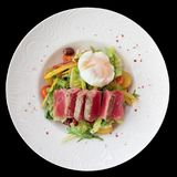 Nicoise salad of rare fried tuna, potato, salad mix and poached Stock Images