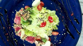 Nicoise salad top view. Lettuce, cherry tomato and tuna stock video footage