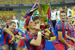 Nicolae Stanciu of Steaua Bucharest rising the trophy Stock Photography